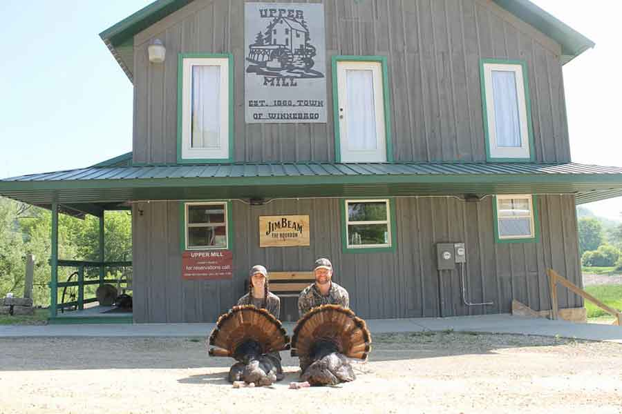 "Turkey Hunting Couple in front of ""The Mill"" at Winnebago Valley Hideaway"